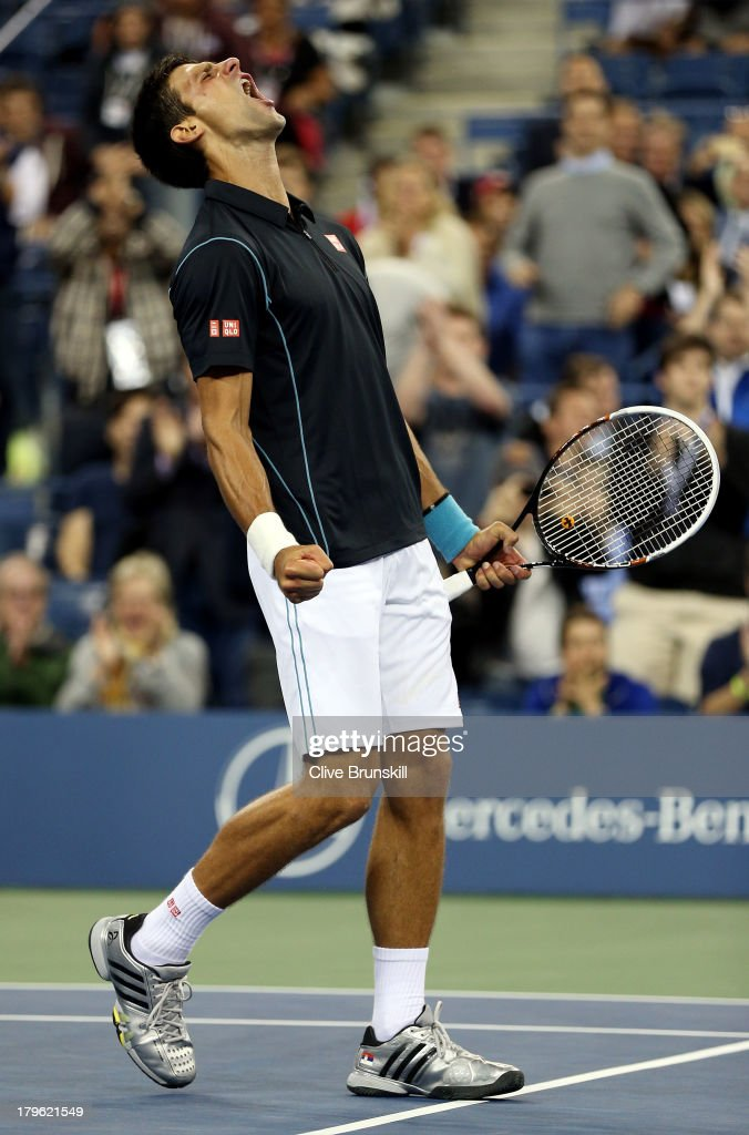 <a gi-track='captionPersonalityLinkClicked' href=/galleries/search?phrase=Novak+Djokovic&family=editorial&specificpeople=588315 ng-click='$event.stopPropagation()'>Novak Djokovic</a> of Serbia celebrates victory during his men's singles quarterfinal match against Mikhail Youzhny of Russia on Day Eleven of the 2013 US Open at USTA Billie Jean King National Tennis Center on September 5, 2013 in the Flushing neighborhood of the Queens borough of New York City.