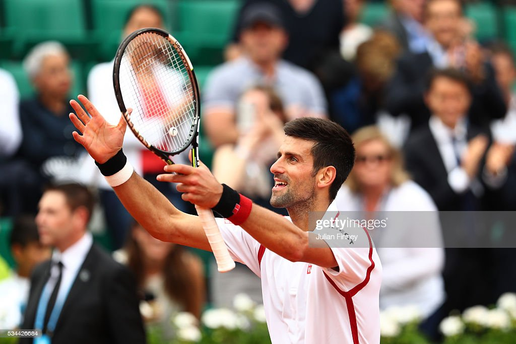 <a gi-track='captionPersonalityLinkClicked' href=/galleries/search?phrase=Novak+Djokovic&family=editorial&specificpeople=588315 ng-click='$event.stopPropagation()'>Novak Djokovic</a> of Serbia celebrates victory during the Men's Singles second round match against Steve Darcis of Belgium on day five of the 2016 French Open at Roland Garros on May 26, 2016 in Paris, France.