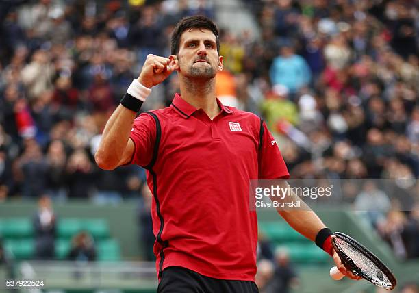 Novak Djokovic of Serbia celebrates victory during the Men's Singles semi final match against Dominic Thiem of Austria on day thirteen of the 2016...