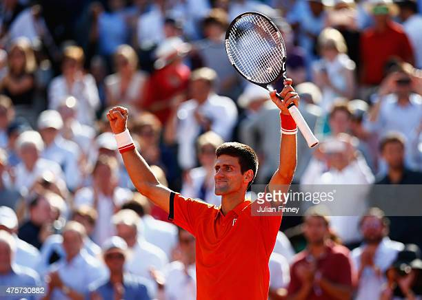 Novak Djokovic of Serbia celebrates victory in his Men's quarter final match against Rafael Nadal of Spain on day eleven of the 2015 French Open at...