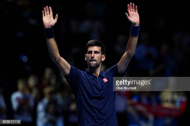 Novak Djokovic of Serbia celebrates victory in his men's singles match against Dominic Thiem of Austria on day one of the ATP World Tour Finals at O2...