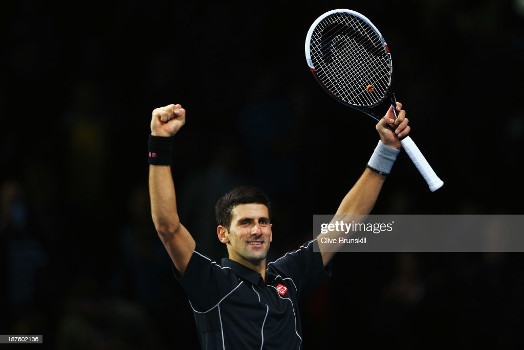 <a gi-track='captionPersonalityLinkClicked' href=/galleries/search?phrase=Novak+Djokovic&family=editorial&specificpeople=588315 ng-click='$event.stopPropagation()'>Novak Djokovic</a> of Serbia celebrates victory in his men's singles semi-final match against <a gi-track='captionPersonalityLinkClicked' href=/galleries/search?phrase=Stanislas+Wawrinka&family=editorial&specificpeople=557155 ng-click='$event.stopPropagation()'>Stanislas Wawrinka</a> of Switzerland during day seven of the Barclays ATP World Tour Finals at O2 Arena on November 10, 2013 in London, England.