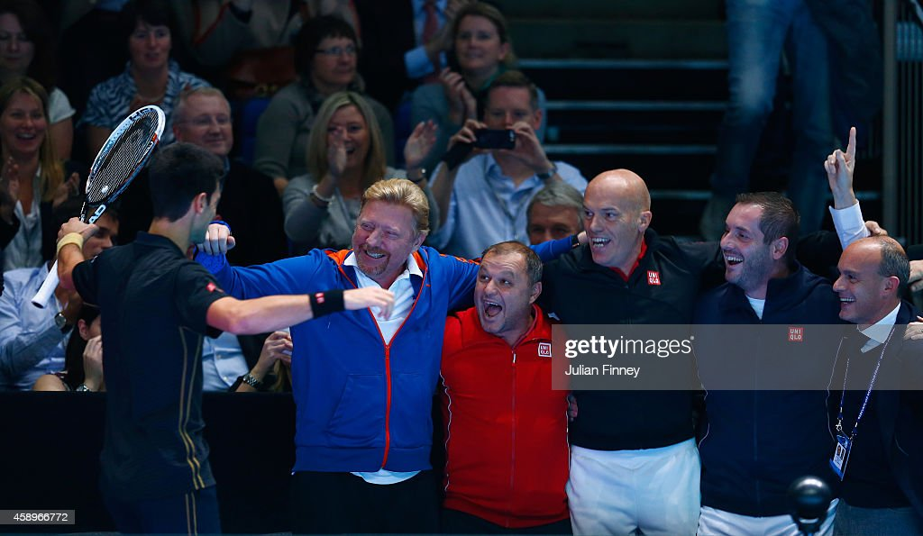 <a gi-track='captionPersonalityLinkClicked' href=/galleries/search?phrase=Novak+Djokovic&family=editorial&specificpeople=588315 ng-click='$event.stopPropagation()'>Novak Djokovic</a> of Serbia celebrates victory with his coaching staff (L-R) <a gi-track='captionPersonalityLinkClicked' href=/galleries/search?phrase=Boris+Becker&family=editorial&specificpeople=67204 ng-click='$event.stopPropagation()'>Boris Becker</a>, Marian Vajda, physiotherapist Milan Amanovic after the round robin singles match against <a gi-track='captionPersonalityLinkClicked' href=/galleries/search?phrase=Tomas+Berdych&family=editorial&specificpeople=239147 ng-click='$event.stopPropagation()'>Tomas Berdych</a> of Czech Republic on day six of the Barclays ATP World Tour Finals at O2 Arena on November 14, 2014 in London, England.