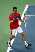 Novak Djokovic of Serbia celebrates winning a game against Gilles Simon of France during day one of the Davis Cup Tennis Final at the Begrade Arena...