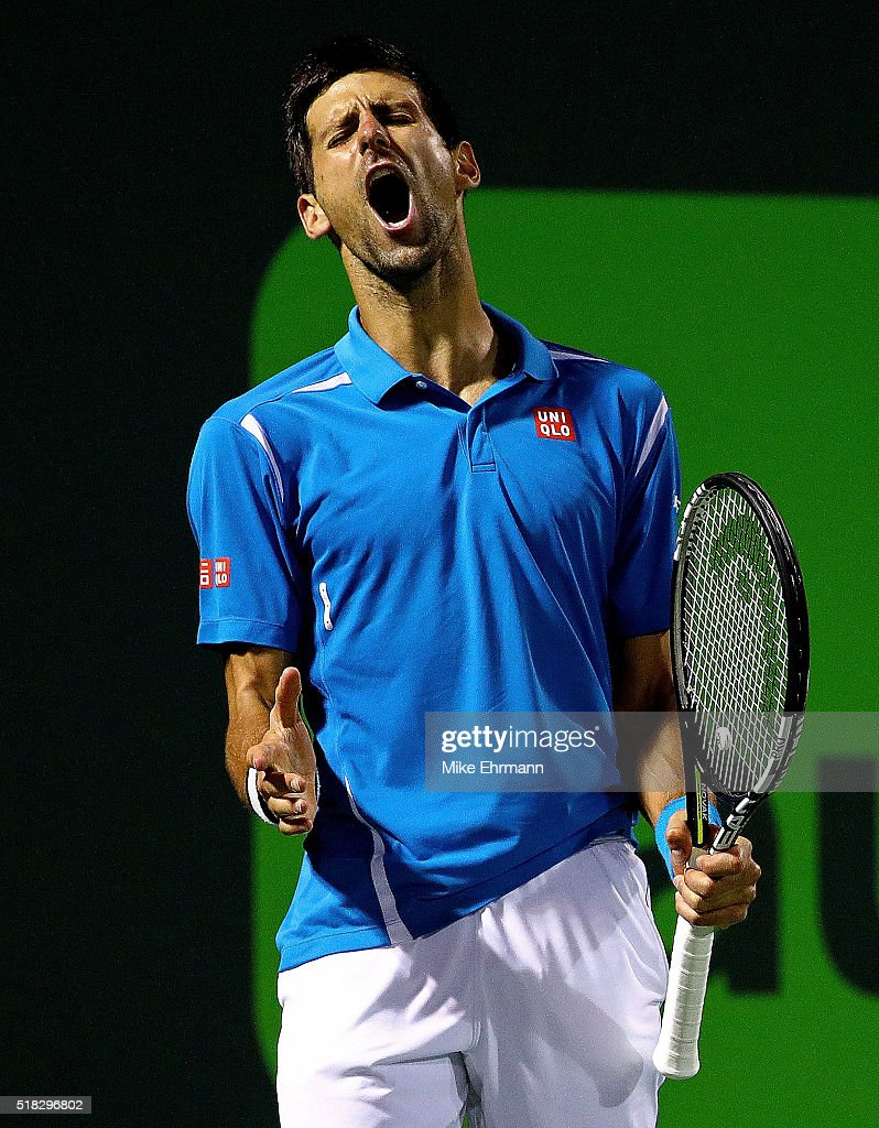 Novak Djokovic of Serbia celebrates winning a point against Tomas Berdych of the Czech Republic during Day 10 of the Miami Open presented by Itau at...