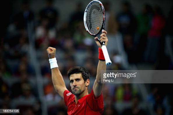 Novak Djokovic of Serbia celebrates winning against Rafael Nadal of Spain during the Men's Single Final on night day of the China Open at the China...