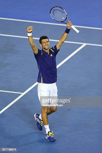 Novak Djokovic of Serbia celebrates winning championship point in the Men's Singles Final match against Andy Murray of Great Britain during day 14 of...