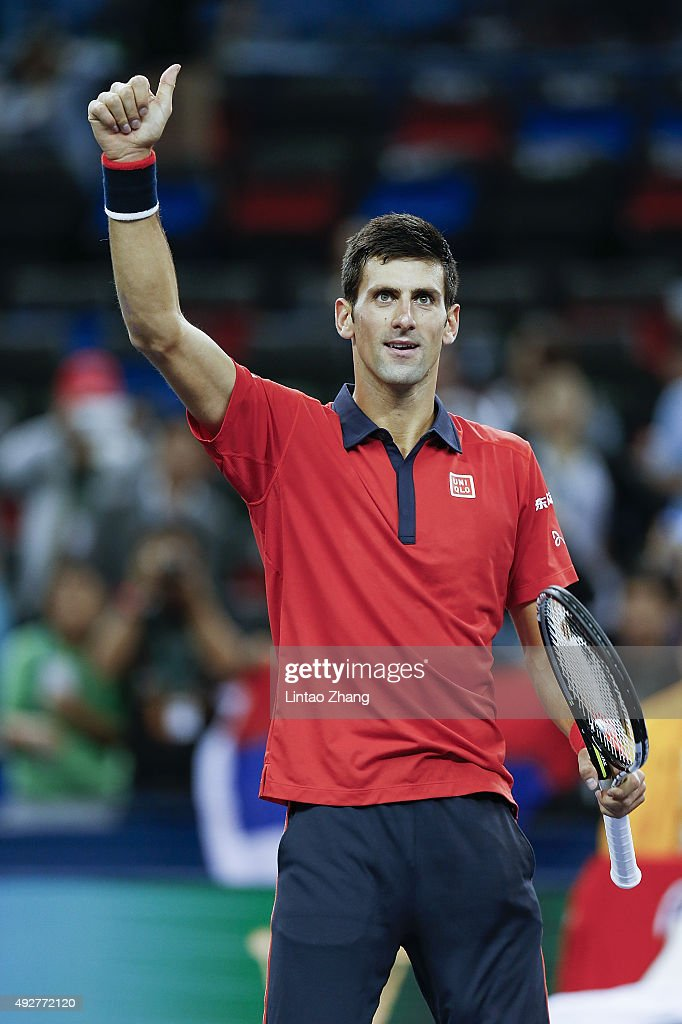 Novak Djokovic of Serbia celebrates winning his men's singles third round match against Feliciano Lopez of Spain on day 5 of Shanghai Rolex Masters at Qi Zhong Tennis Centre on October 15, 2015 in Shanghai, China.
