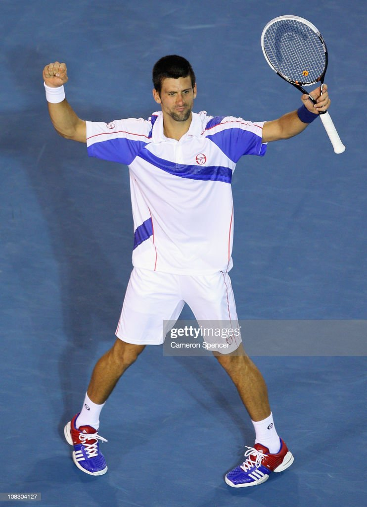 Novak Djokovic of Serbia celebrates winning his quarterfinal match against Tomas Berdych of the Czech Republic during day nine of the 2011 Australian Open at Melbourne Park on January 25, 2011 in Melbourne, Australia.