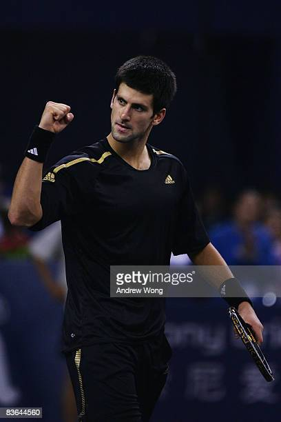 Novak Djokovic of Serbia celebrates winning his round robin match against Nikolay Davydenko of Russia in the Tennis Masters Cup held at Qi Zhong...