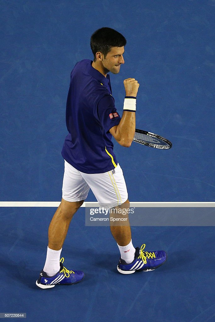 Novak Djokovic of Serbia celebrates winning his semi final match against Roger Federer of Switzerland during day 11 of the 2016 Australian Open at Melbourne Park on January 28, 2016 in Melbourne, Australia.