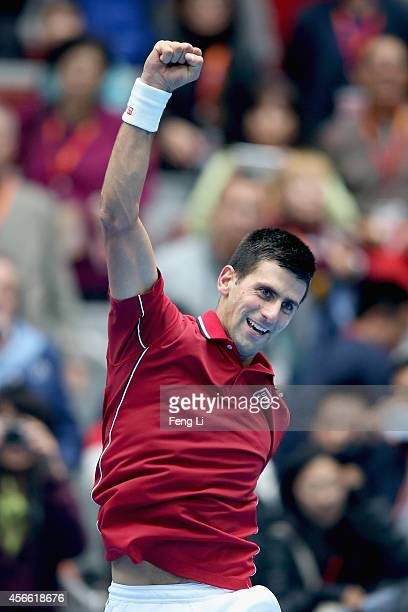Novak Djokovic of Serbia celebrates winning his semifinal match against Andy Murray of Great Britain during day eight of the China Open at the China...