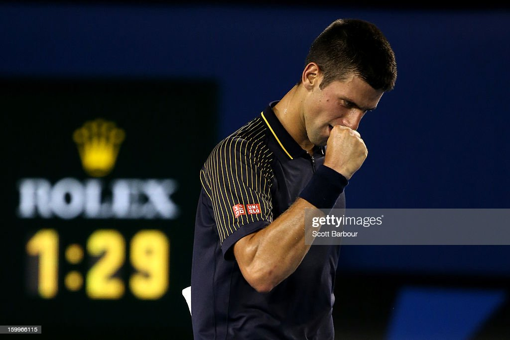 <a gi-track='captionPersonalityLinkClicked' href=/galleries/search?phrase=Novak+Djokovic&family=editorial&specificpeople=588315 ng-click='$event.stopPropagation()'>Novak Djokovic</a> of Serbia celebrates winning his Semifinal match against David Ferrer of Spain during day eleven of the 2013 Australian Open at Melbourne Park on January 24, 2013 in Melbourne, Australia.