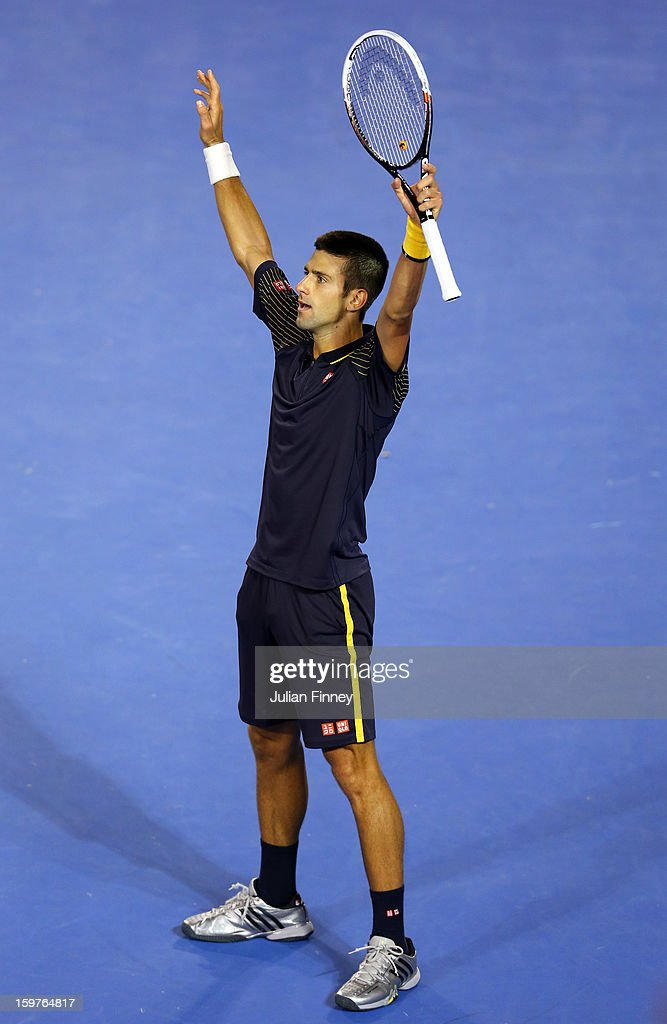 <a gi-track='captionPersonalityLinkClicked' href=/galleries/search?phrase=Novak+Djokovic&family=editorial&specificpeople=588315 ng-click='$event.stopPropagation()'>Novak Djokovic</a> of Serbia celebrates winning in five sets in his fourth round match against Stanislas Wawrinka of Switzerland during day seven of the 2013 Australian Open at Melbourne Park on January 20, 2013 in Melbourne, Australia
