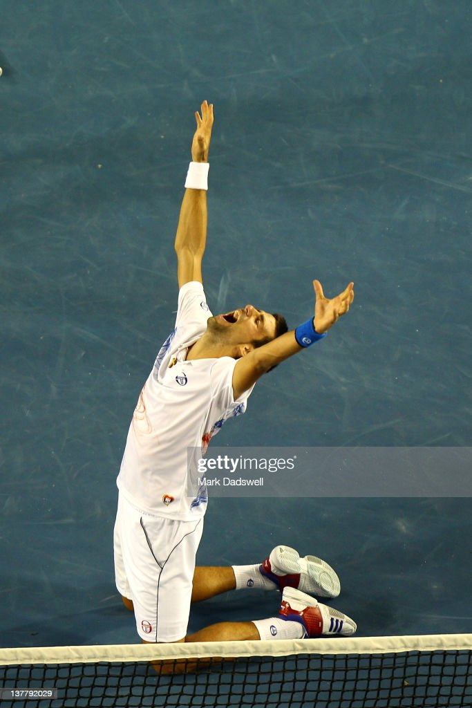 <a gi-track='captionPersonalityLinkClicked' href=/galleries/search?phrase=Novak+Djokovic&family=editorial&specificpeople=588315 ng-click='$event.stopPropagation()'>Novak Djokovic</a> of Serbia celebrates winning match point in his semifinal match against Andy Murray of Great Britain during day twelve of the 2012 Australian Open at Melbourne Park on January 27, 2012 in Melbourne, Australia.