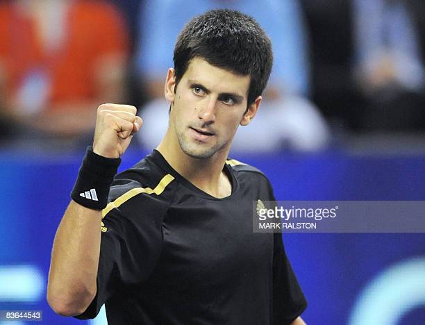 Novak Djokovic of Serbia celebrates winning match point over Nikolay Davydenko of Russia in their men's singles match on the third day of the ATP...