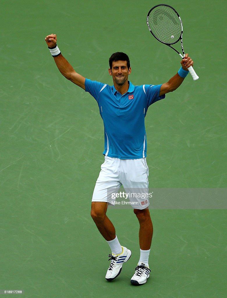 Novak Djokovic of Serbia celebrates winning the Men's Final against Kei Nishikori of Japan during Day 14 of the Miami Open presented by Itau at...