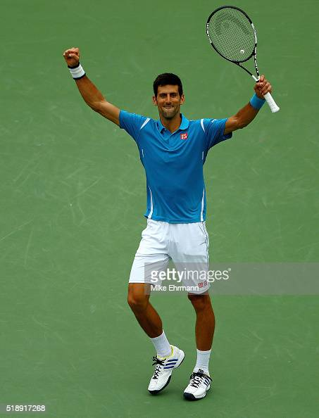 Novak Djokovic of Serbia celebrates winning the Men's Final against Kei Nishikori of Japan during Day 14 of the Miami Open presented by Itau at...