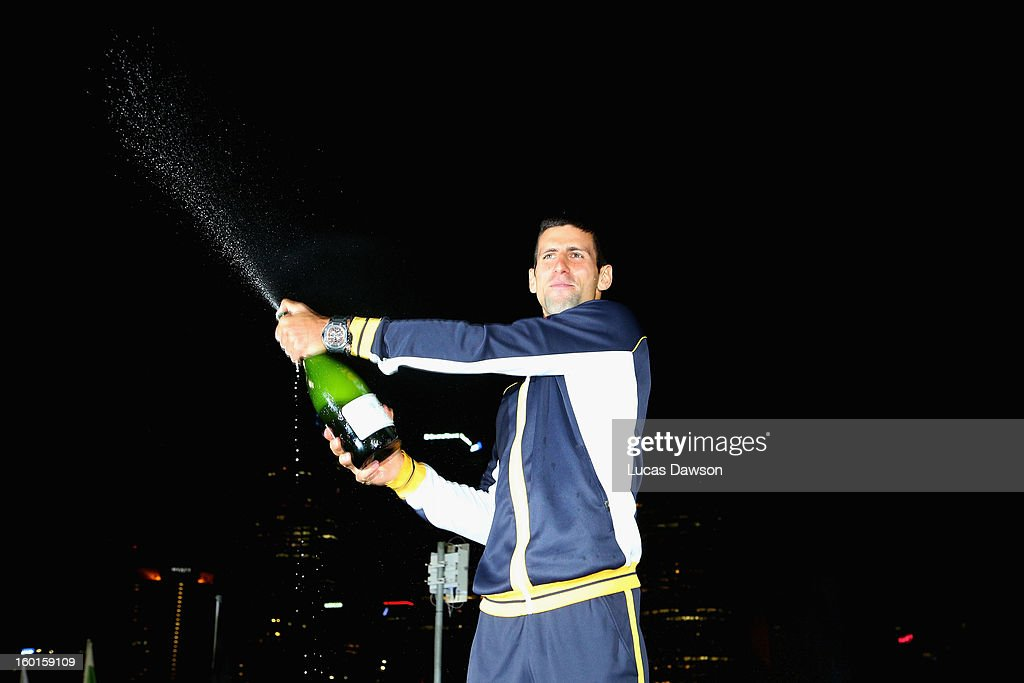 <a gi-track='captionPersonalityLinkClicked' href=/galleries/search?phrase=Novak+Djokovic&family=editorial&specificpeople=588315 ng-click='$event.stopPropagation()'>Novak Djokovic</a> of Serbia celebrates with a bottle of champagne in the early hours of January 28, 2013 after winning his men's final match against Andy Murray of Great Britain during day fourteen of the 2013 Australian Open at Melbourne Park on January 28, 2013 in Melbourne, Australia.