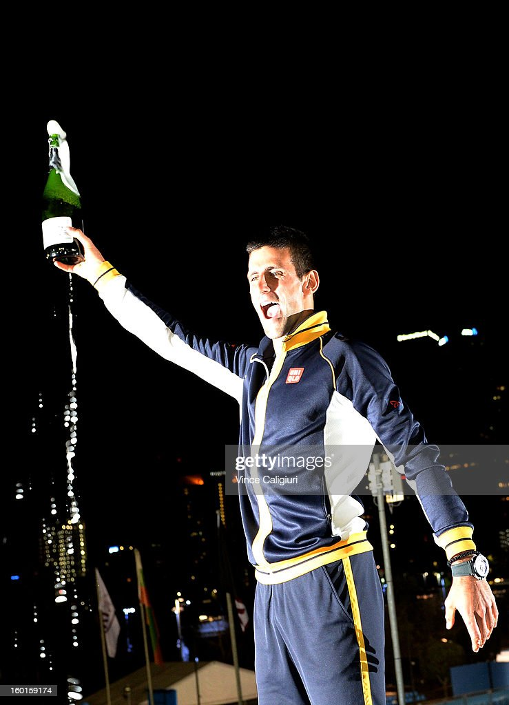 <a gi-track='captionPersonalityLinkClicked' href=/galleries/search?phrase=Novak+Djokovic&family=editorial&specificpeople=588315 ng-click='$event.stopPropagation()'>Novak Djokovic</a> of Serbia celebrates with a bottle of champagne in the early hours of January 28, 2013 after winning his men's final match against Andy Murray of Great Britain during day fourteen of the 2013 Australian Open at Melbourne Park on January 27, 2013 in Melbourne, Australia.