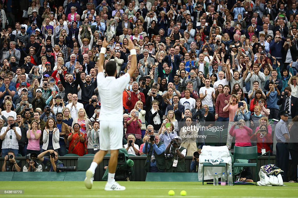 <a gi-track='captionPersonalityLinkClicked' href=/galleries/search?phrase=Novak+Djokovic&family=editorial&specificpeople=588315 ng-click='$event.stopPropagation()'>Novak Djokovic</a> of Serbia celebrates with supporters victory during the Men's Singles second round match against Adrian Mannarino of France on day three of the Wimbledon Lawn Tennis Championships at the All England Lawn Tennis and Croquet Club on June 29, 2016 in London, England.