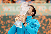 Novak Djokovic of Serbia celebrates with the Butch Buchholz trophy after defeating Kei Nishikori of Japan during the final on Day 14 of the Miami...