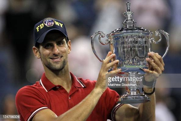 Novak Djokovic of Serbia celebrates with the trophy after he defeated Rafael Nadal of Spain during the Men's Final on Day Fifteen of the 2011 US Open...