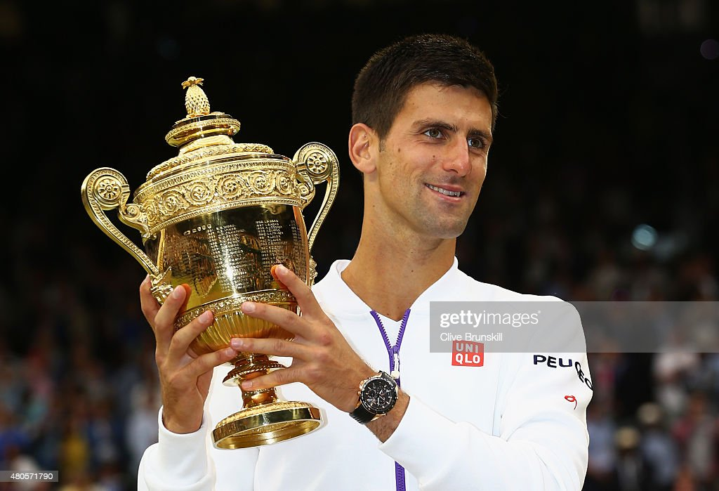 Novak Djokovic of Serbia celebrates with the trophy after winning the Final Of The Gentlemen's Singles against Roger Federer of Switzerland on day thirteen of the Wimbledon Lawn Tennis Championships at the All England Lawn Tennis and Croquet Club on July 12, 2015 in London, England.