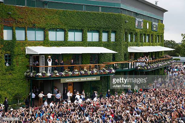 Novak Djokovic of Serbia celebrates with the trophy on the clubhouse balcony after winning the Final Of The Gentlemen's Singles against Roger Federer...