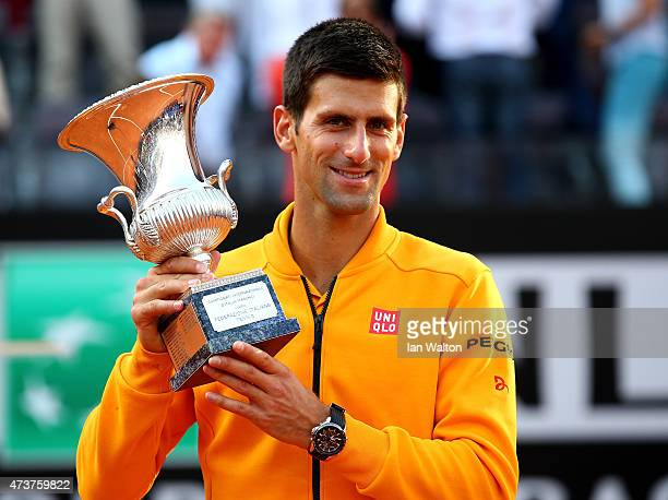 Novak Djokovic of Serbia celebrates with the Winner's Trophy after his victory over Roger Federer of Switzerland in the Men's Singles Final on Day...