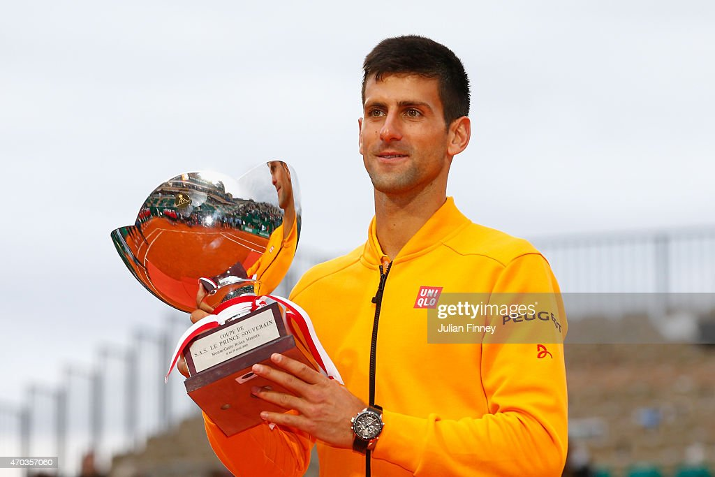Novak Djokovic of Serbia celebrates with the winners trophy after defeating Tomas Berdych of Czech Republic in the final during day eight of the...