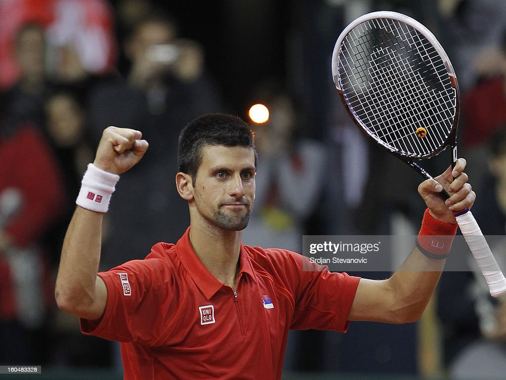 Novak Djokovic of Serbia celebratesn victory against Olivier Rochus of Belgium after the Davis Cup singles first round match between Belgium and Serbia, at Spirou dome February 01, 2013 in Charleroi, Belgium.