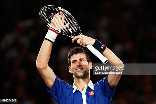 Novak Djokovic of Serbia celebrtes after victory against Andy Murray of Great Britain after their Mens Final match during Day 7 of the BNP Paribas...