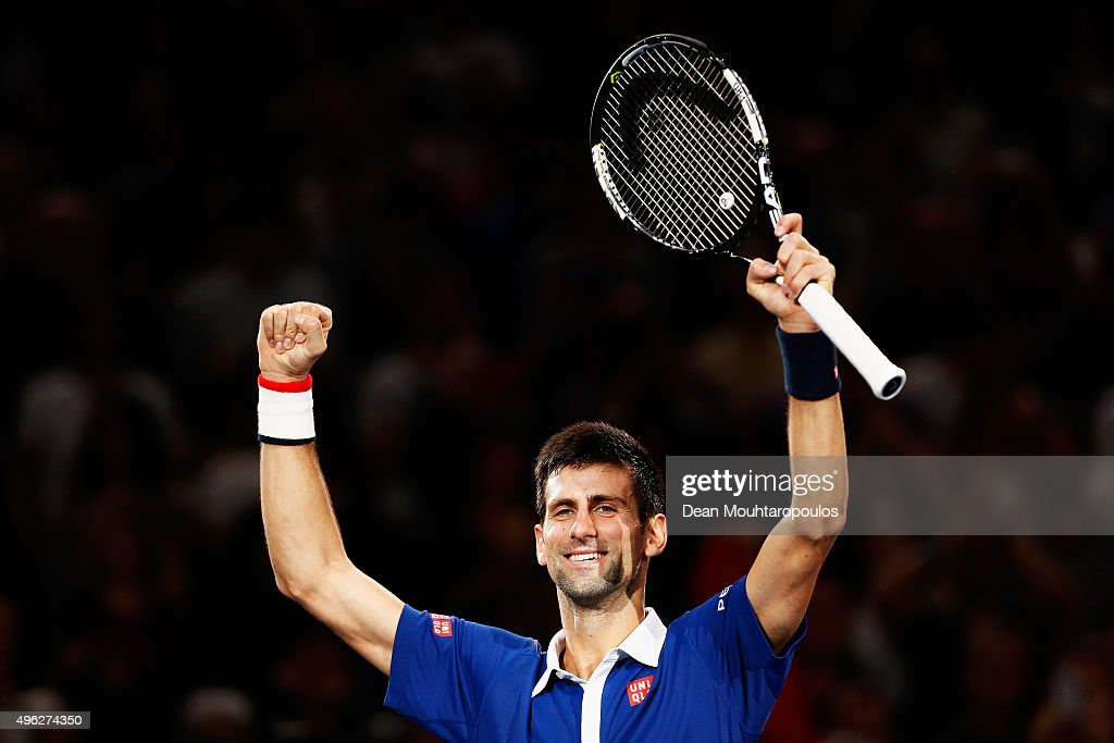 Novak Djokovic of Serbia celebrtes after victory against Andy Murray of Great Britain after their Mens Final match during Day 7 of the BNP Paribas Masters held at AccorHotels Arena on November 8, 2015 in Paris, France.