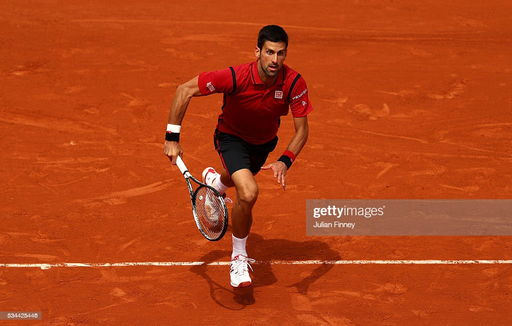 <a gi-track='captionPersonalityLinkClicked' href=/galleries/search?phrase=Novak+Djokovic&family=editorial&specificpeople=588315 ng-click='$event.stopPropagation()'>Novak Djokovic</a> of Serbia chases down the ball during the Men's Singles second round match against Steve Darcis of Belgium on day five of the 2016 French Open at Roland Garros on May 26, 2016 in Paris, France.