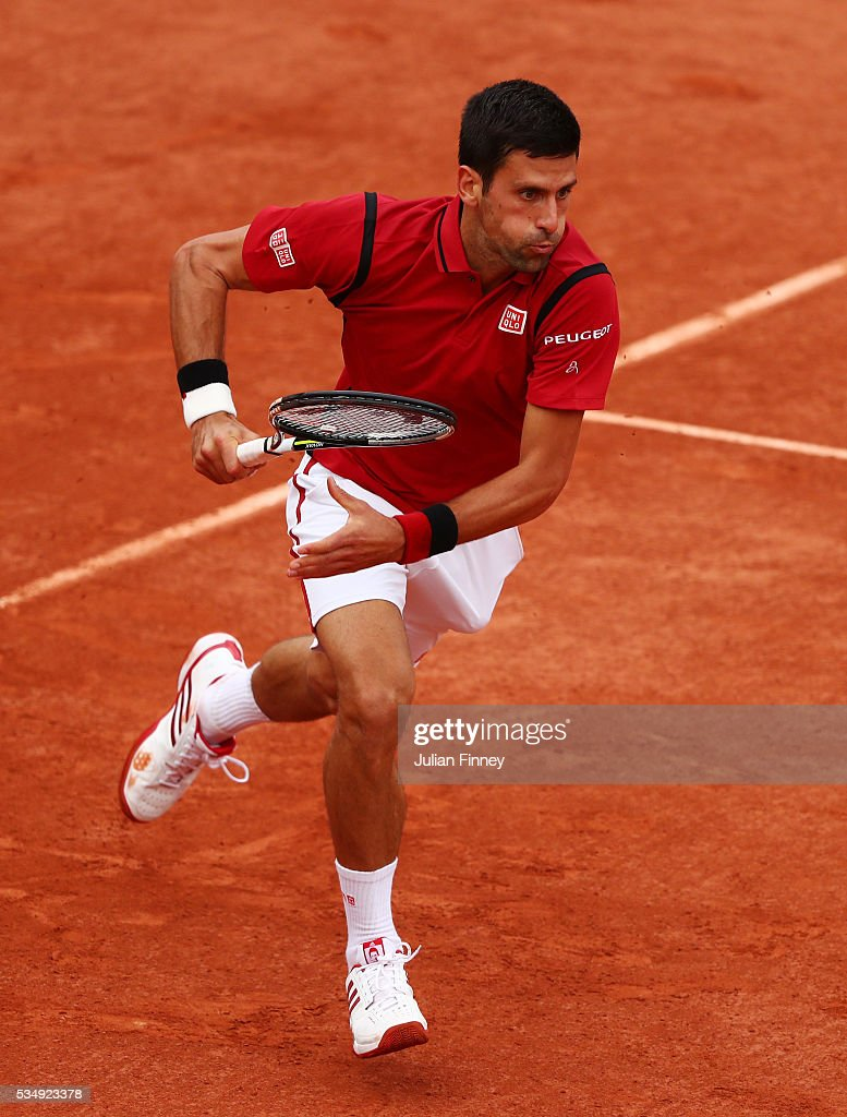 Novak Djokovic of Serbia chases down the ball during the Men's Singles third round match against Aljaz Bedene of Great Britain on day seven of the 2016 French Open at Roland Garros on May 28, 2016 in Paris, France.