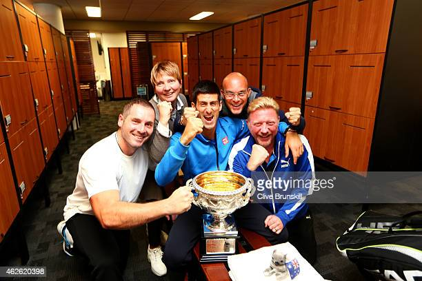 Novak Djokovic of Serbia coach Boris Becker agent Edoardo Artaldi and agent Elena Cappellaro pose with the Norman Brookes Challenge Cup after...