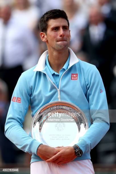 Novak Djokovic of Serbia cries after his defeat in the men's singles final match against Rafael Nadal of Spain on day fifteen of the French Open at...
