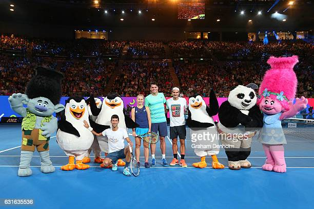 Novak Djokovic of Serbia Daria Gavrilova of Australia Milos Raonic of Canada and Roger Federer of Switzerland pose with DreamWorks characters...