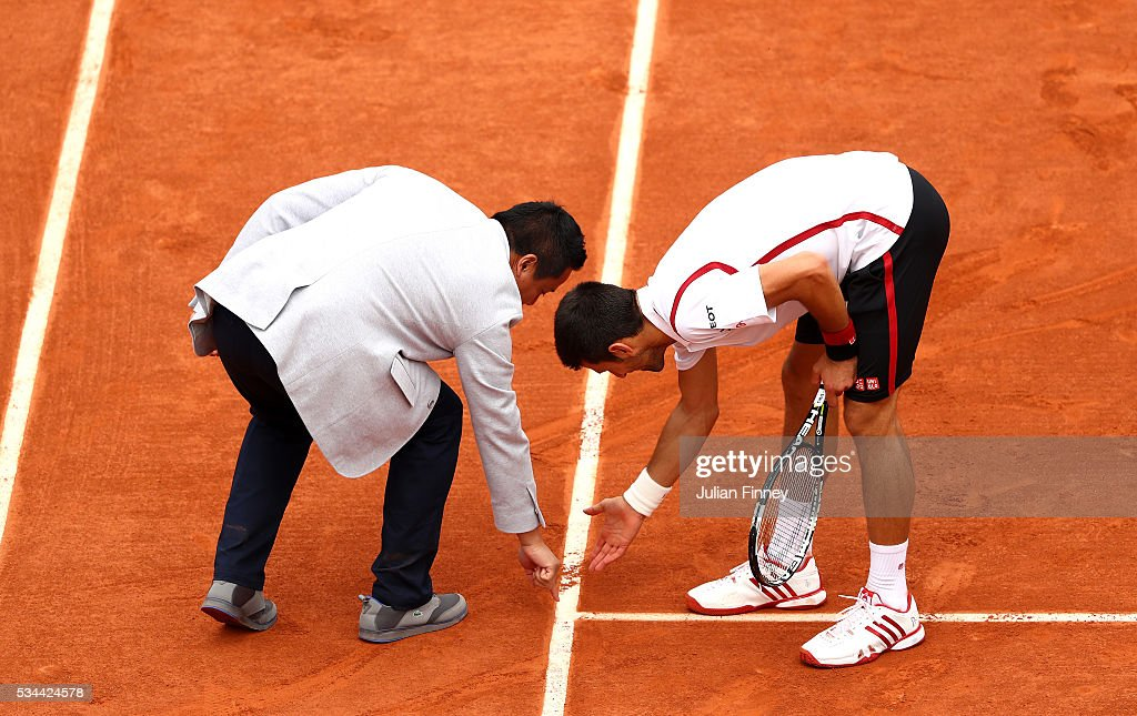 Novak Djokovic of Serbia disputes a call during the Men's Singles second round match against Steve Darcis of Belgium on day five of the 2016 French Open at Roland Garros on May 26, 2016 in Paris, France.
