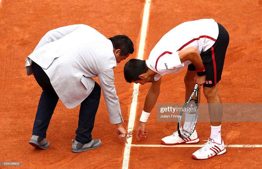 <a gi-track='captionPersonalityLinkClicked' href=/galleries/search?phrase=Novak+Djokovic&family=editorial&specificpeople=588315 ng-click='$event.stopPropagation()'>Novak Djokovic</a> of Serbia disputes a call during the Men's Singles second round match against Steve Darcis of Belgium on day five of the 2016 French Open at Roland Garros on May 26, 2016 in Paris, France.