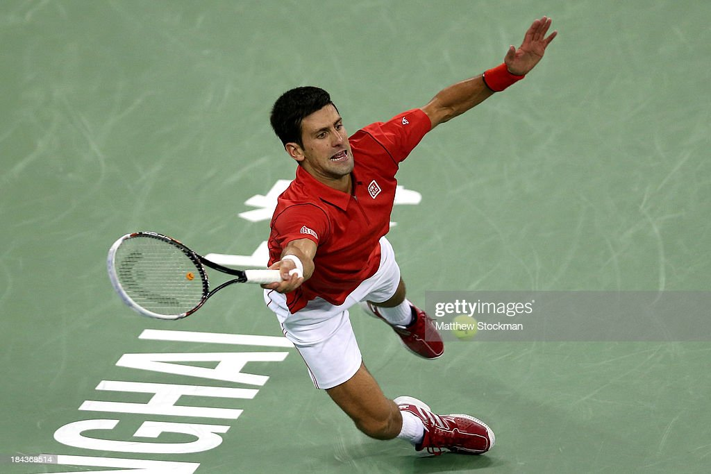 <a gi-track='captionPersonalityLinkClicked' href=/galleries/search?phrase=Novak+Djokovic&family=editorial&specificpeople=588315 ng-click='$event.stopPropagation()'>Novak Djokovic</a> of Serbia dives for a shot while playing Juan Martin Del Potro of Argentina during the final of the Shanghai Rolex Masters at the Qi Zhong Tennis Center on October 13, 2013 in Shanghai, China.