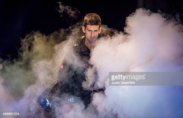 Novak Djokovic of Serbia enters the court ahead of his round robin singles match against Stan Wawrinka of Switzerland on day four of the Barclays ATP...