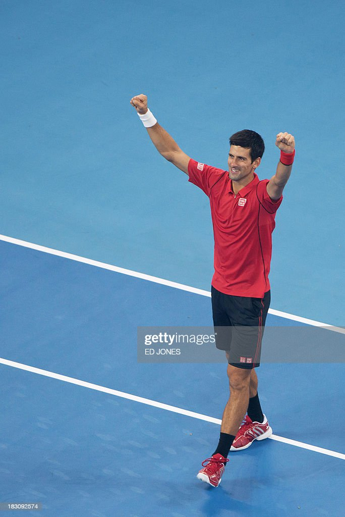Novak Djokovic of Serbia gestures after defeating Sam Querrey of the US during their men's quarter final match at the China Open tennis tournament in Beijing on October 4, 2013. Djokovic won 6:1, 6:2. AFP PHOTO / Ed Jones