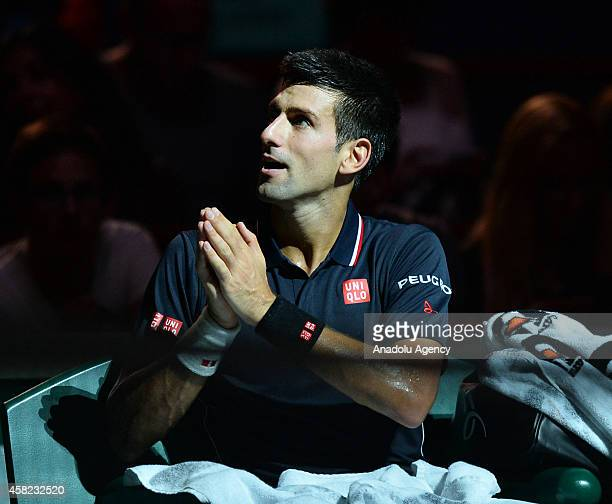 Novak Djokovic of Serbia gestures during the BNP Paribas Masters 2014 tennis tournament semifinals match against Kei Nishikori of Japan in Paris...