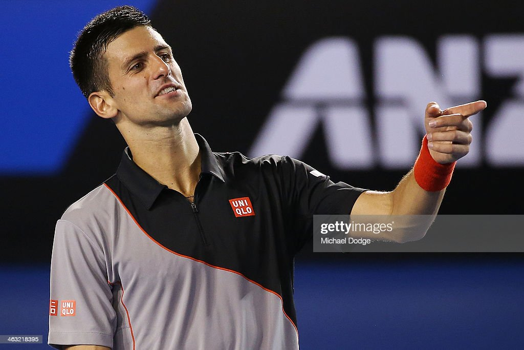 Novak Djokovic of Serbia gestures in his third round match against Denis Istomin of Uzbekistan during day five of the 2014 Australian Open at Melbourne Park on January 17, 2014 in Melbourne, Australia.