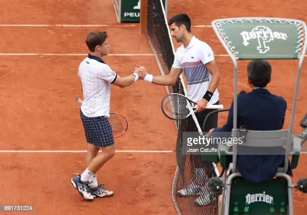 Novak Djokovic of Serbia greets at the net Diego Schwartzman of Argentina after his victory on day 6 of the 2017 French Open second Grand Slam of the...