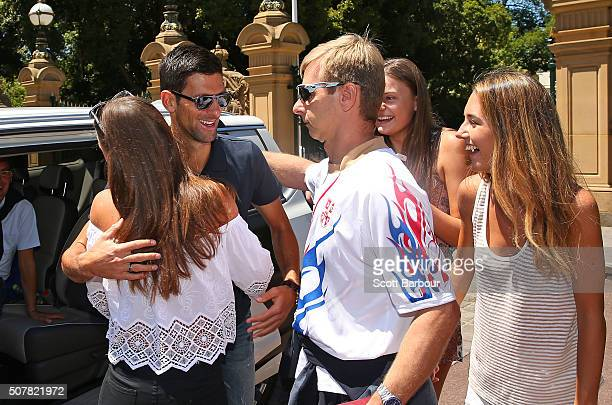 Novak Djokovic of Serbia greets supporters after winning the Men's Singles Final during the Australian Open 2016 Men's Champion Photocall at...