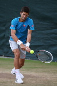 Novak Djokovic of Serbia hits a backhand during a practice session on day ten of the Wimbledon Lawn Tennis Championships at the All England Lawn...