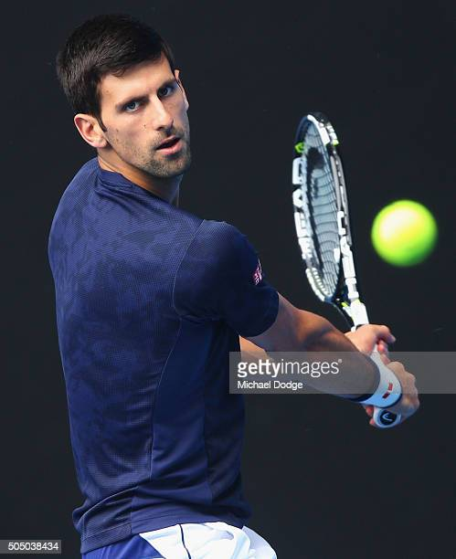 Novak Djokovic of Serbia hits a backhand during a practice session ahead of the 2016 Australian Open at Melbourne Park on January 15 2016 in...